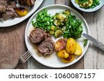 easter meal with roast lamb ... | Shutterstock . vector #1060087157