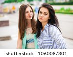 Small photo of Empty chatter from which the head hurts. Two young women talking on the street