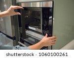 woman's hands pressing button... | Shutterstock . vector #1060100261