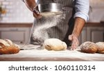hands of the baker's male knead ... | Shutterstock . vector #1060110314