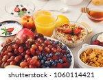 fresh healthy breakfast with... | Shutterstock . vector #1060114421