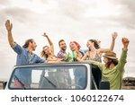 group of happy friends cheering ... | Shutterstock . vector #1060122674