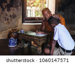 monk teaching children books in ... | Shutterstock . vector #1060147571