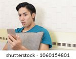 young man with a smartphone | Shutterstock . vector #1060154801