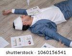 sick businessman sleeping on... | Shutterstock . vector #1060156541