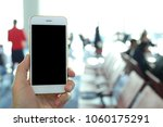 hand holding mockup smartphone... | Shutterstock . vector #1060175291