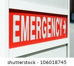 A Red Emergency Sign At The...