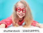 funny little blonde girl with... | Shutterstock . vector #1060189991