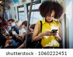 young woman using a smartphone... | Shutterstock . vector #1060222451