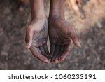 selective focus. hands poor... | Shutterstock . vector #1060233191