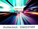 moving traffic light trails at... | Shutterstock . vector #1060237499