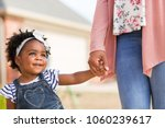 little girl holding her mothers ... | Shutterstock . vector #1060239617