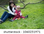 easter   eggs  mama and boy | Shutterstock . vector #1060251971