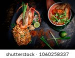 Stock photo concept pictures of famouse thai dishes tom yum kung phad thai beautiful presentation on black 1060258337
