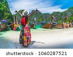 Traveler Asian woman in summer dress joy relaxing on natural sea beach, Maya beach, Phi Phi island, Krabi, Travel in Thailand, Beautiful destination place Asia, Summer holiday outdoor vacation trip