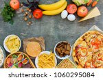 fastfood and healthy food on... | Shutterstock . vector #1060295084