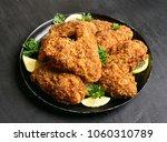appetizing crispy chicken wings....   Shutterstock . vector #1060310789