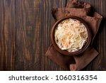 sauerkraut with carrots in bowl ... | Shutterstock . vector #1060316354