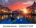 a gondola service near rialto... | Shutterstock . vector #1060317149