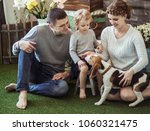 happy family and pet dog on the ... | Shutterstock . vector #1060321475