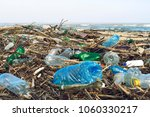 spilled garbage on the beach of ... | Shutterstock . vector #1060330217