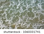 top view on moving sea water... | Shutterstock . vector #1060331741
