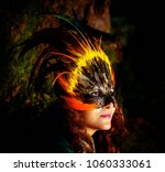 girl with shamanic feather mask ...   Shutterstock . vector #1060333061