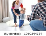 happy family playing and baby... | Shutterstock . vector #1060344194