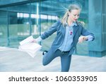 businesswoman hurrying to... | Shutterstock . vector #1060353905