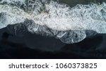 the black sand beach in iceland.... | Shutterstock . vector #1060373825