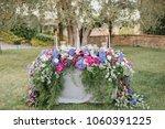 flower arrangement stands on... | Shutterstock . vector #1060391225
