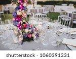 flower arrangement stands on... | Shutterstock . vector #1060391231