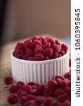 bowl of fresh raspberries   Shutterstock . vector #1060395845