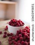 bowl of fresh raspberries   Shutterstock . vector #1060395851