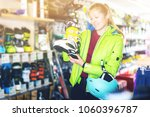 young customer woman in ski... | Shutterstock . vector #1060396787