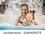 woman and her little daughter... | Shutterstock . vector #1060409375