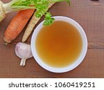 clear beef broth  bone broth ... | Shutterstock . vector #1060419251