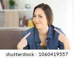proud woman pointing herself... | Shutterstock . vector #1060419557