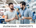 salesman in checkered shirt is... | Shutterstock . vector #1060422071