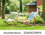 two sunbeds with green and blue ... | Shutterstock . vector #1060424894