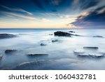 sunrise at a moody kingsbarns... | Shutterstock . vector #1060432781