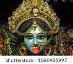 deity of god kali in blue face...   Shutterstock . vector #1060435997