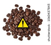 Small photo of Acrylamide warning sign on coffee beans pile isolated on white background