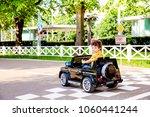 amusement park  a funny boy... | Shutterstock . vector #1060441244