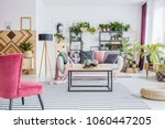 red armchair on patterned... | Shutterstock . vector #1060447205