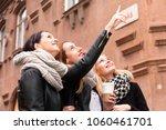 three cheerful modern female... | Shutterstock . vector #1060461701
