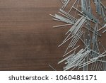 new nails on the wooden table... | Shutterstock . vector #1060481171
