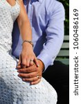 Small photo of Just married. Gold rings on the fingers of a young couple who just married.