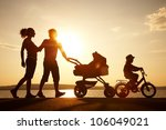 silhouettes of happy parents... | Shutterstock . vector #106049021