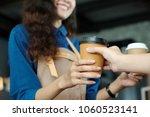 young asian woman barista... | Shutterstock . vector #1060523141